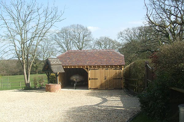 oak-garage-and-car-port-half-hipped-catslide-roof